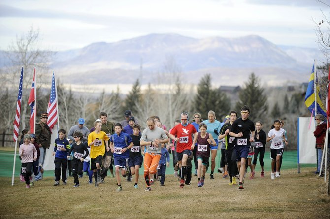Runners leave the starting line during the Stride for the Glide running race Saturday at the Steamboat Ski Touring Center.