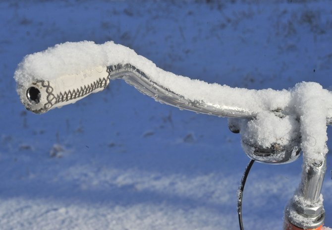 Snow clings to the handlebars of a bike parked in downtown Steamboat Springs on Monday morning. Residents of Steamboat Springs woke up to a snow-covered landscape.