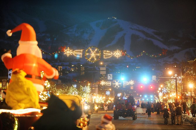 Floats drive down Lincoln Avenue during the Merry Mainstreet holiday celebration in 2010 in downtown Steamboat Springs.