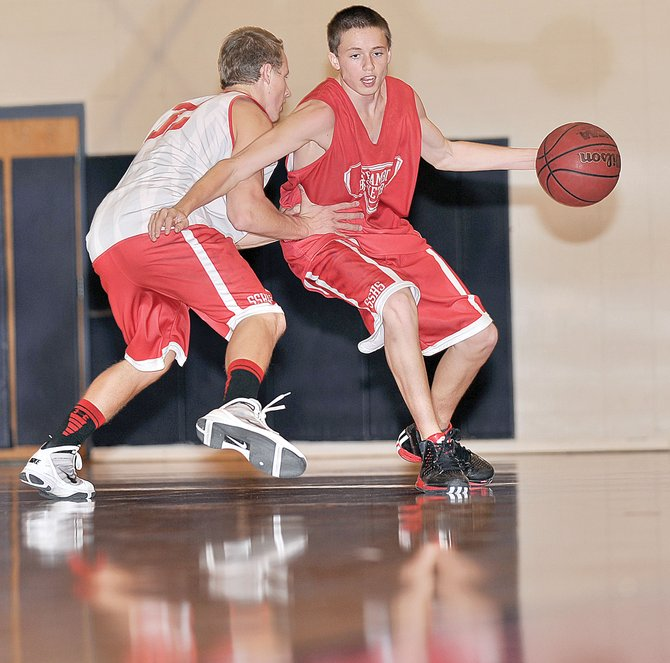 Brody King works the ball up the court against teammate Mitch McCannon during a drill Tuesday afternoon at Steamboat Springs High School. The Sailors were preparing for Thursday's 6:30 p.m. game against Montezuma-Cortez as part of the Steamboat Springs Shoot-Out. The Steamboat Springs girls will play at 8:15 p.m. against Montezuma-Cortez.