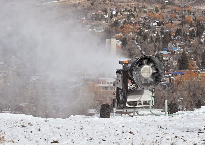 A snowmaking gun blows snow at the top of Howelsen Hill on Monday before noon. Crews at the downtown ski area have been busy working to maintain and open new terrain. Some good news is in the forecast for Steamboat Ski Area, where snow is expected Wednesday night above 8,500 feet.