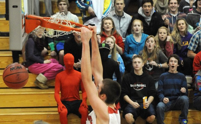 Garrett Bye throws down a dunk Thursday, much to the amazement of his classmates cheering on the Sailors in the Steamboat Springs High School student section. The Sailors won the game against Montezuma-Cortez and will play at 8:15 p.m. Friday in the semifinals of their tournament, the Steamboat Springs Shoot-Out.