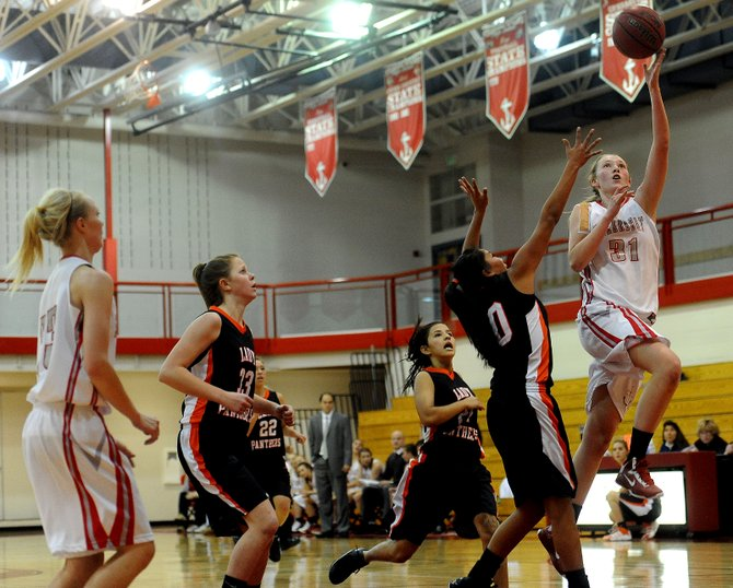 Steamboat&#39;s Maggie Crouch puts up a shot Thursday in what turned out to be a huge first quarter for the Sailors. Steamboat led 27-6 at one point during that period, setting the stage for a big victory in the opening round of the Steamboat Springs Shoot-Out. The Sailors advanced to play Friday in the semifinals.