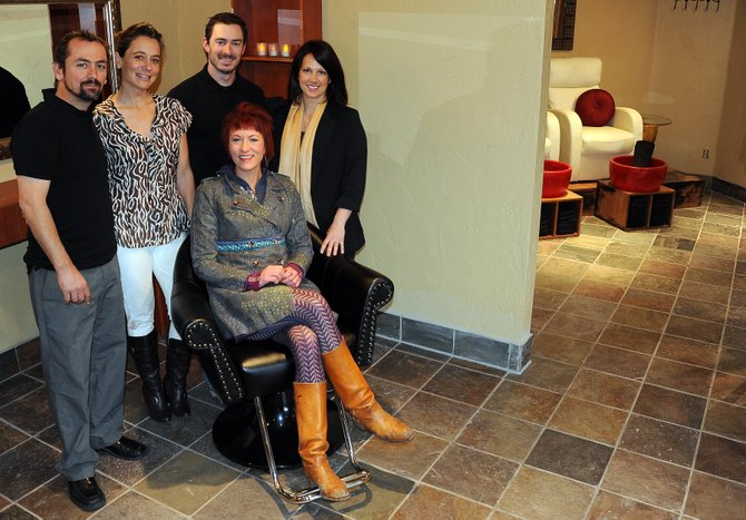 Josh and Seana Cardillo, owners of Rocky Mountain Day Spa, and employees Stephani Weiss, Jascha Bowen-Kreiner and Alli Williams-Smith are excited to open new rooms at their mountain area spa. The additions include a space for couple's massages as well as much more room for nails and, in another new addition, Weiss' hair-styling services.