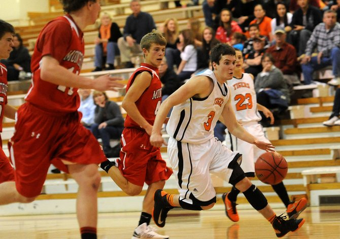Hayden&#39;s Paul Laliberte rushes down the court Friday late in the Tigers&#39; win against Montrose in the Steamboat SpringsShoot-Out. Hayden led big but had to hold on late. That did little to damped the excitement as Hayden, the smallest school in the tournament, earned a chance to play for the championship at 4 p.m. Saturday.