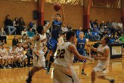 Miguel Cruz puts up a shot versus Meeker on Saturday at Meeker High School. Cruz put in a basket late in the close game to help the Bulldogs maintain their lead and pull out a win.