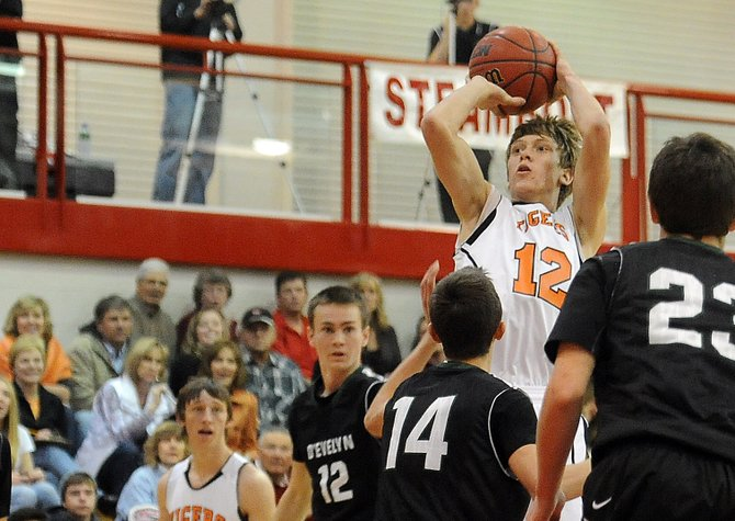 Hayden's Daniel Engle puts up a shot Saturday against D'Evelyn. The Tigers lost the game big but still were happy with their showing in the Steamboat Springs Shoot-Out, where they finished second.