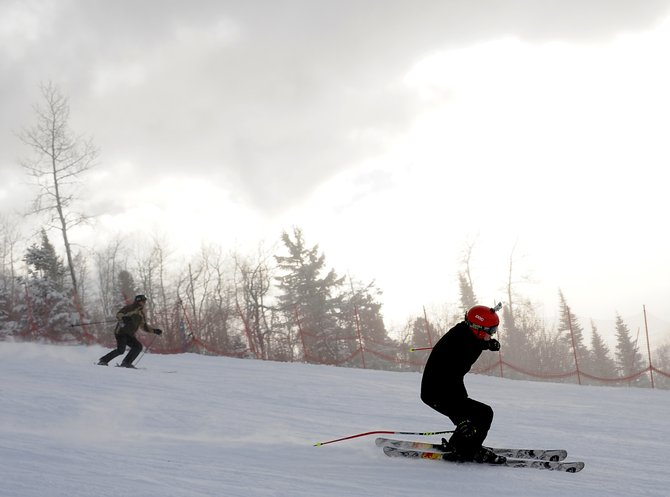 Skiers fly down Sitz at Steamboat Ski Area on Sunday. The morning&#39;s 8 inches of fresh powder drew crowds to the resort&#39;s still-limited runs. More runs are planned to be open Monday, and even more later this week.