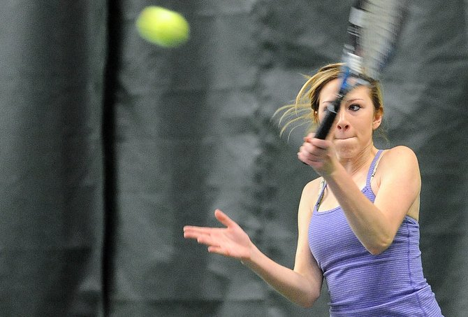 Katie Spencer swings for the ball Sunday during the Steamboat City Singles and Doubles Tournament at the Tennis Center at Steamboat Springs. 