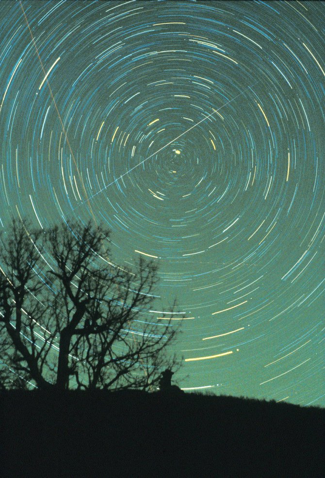 In this one-hour time exposure, the rotation of the Earth caused the stars to leave their curved trails on the film, all centered on the North Star, Polaris, the bright star near the center.