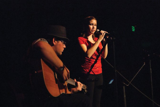 "Moffat County High School senior EJ Hall accompanies Morgan Switzler as she sings ""White Horse"" by Taylor Swift Wednesday night during the MCHS talent show."
