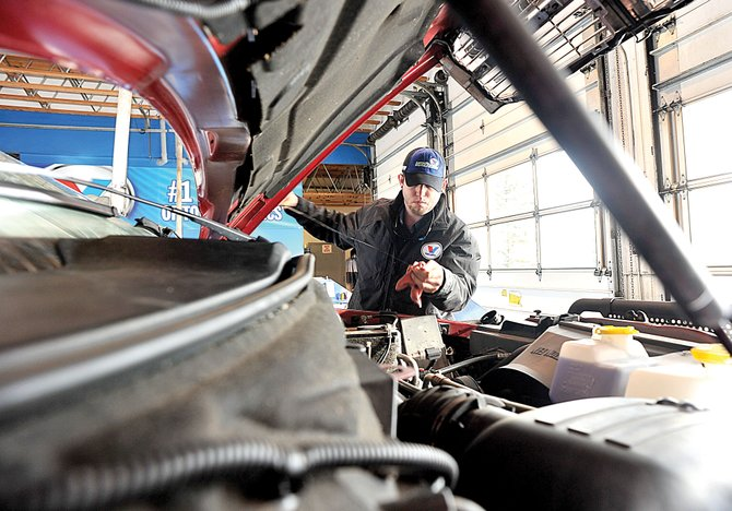 Richard Darsow, manager of the Express Lube portion of Yampa Valley Tire Pros and Express Lube, checks the oil in a pickup at the west Steamboat Springs business. The former Grease Monkey recently changed its name.