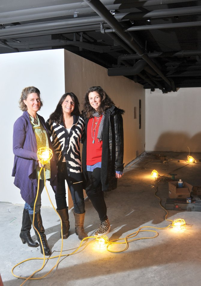 Entrepreneurs Kelly Subr, Kimberly Saari and Christy Borden stand inside the space in Howelsen Place where they will be opening K. Saari Gallery/Soul Sisters Studio.