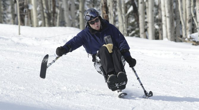 Rick Finkelstein carves down Aspen&#39;s Snowmass mountain. Paralyzed in a ski accident six years earlier, he was linking turns again on his first run. Finkelstein is featured in Steamboat filmmaker Greg Hamilton&#39;s movie &quot;The Movement,&quot; airing Sunday on Fox Sports Net. 