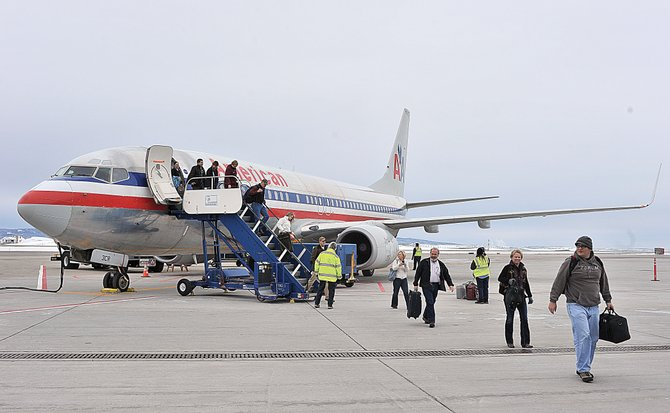 Passengers arrive at Yampa Valley Regional Airport in Hayden on American Airlines flight 1193 from Chicago on Friday. Regular nonstop flights from Chicago and Dallas began Thursday.