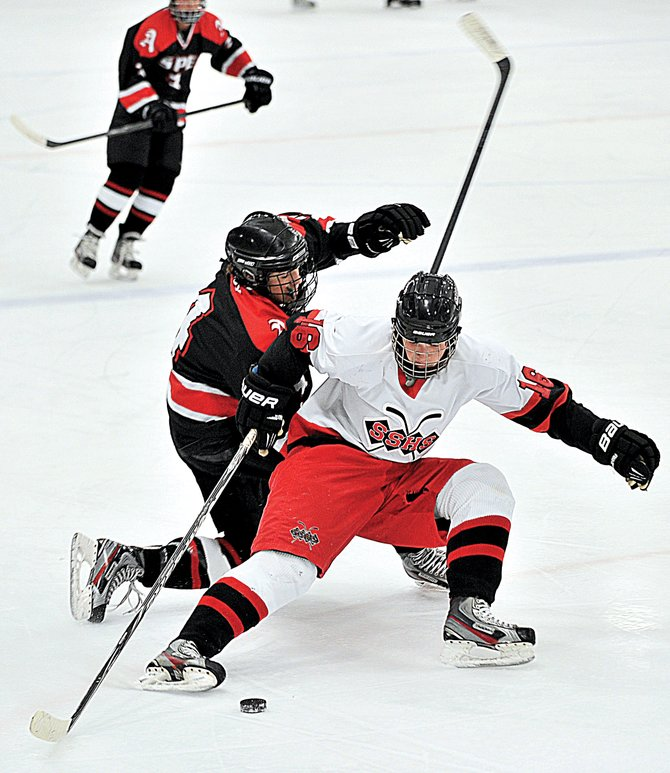 Steamboat Springs forward Matt Hale battles for a loose puck during Friday night&#39;s game against Aspen at Howelsen Ice Arena.