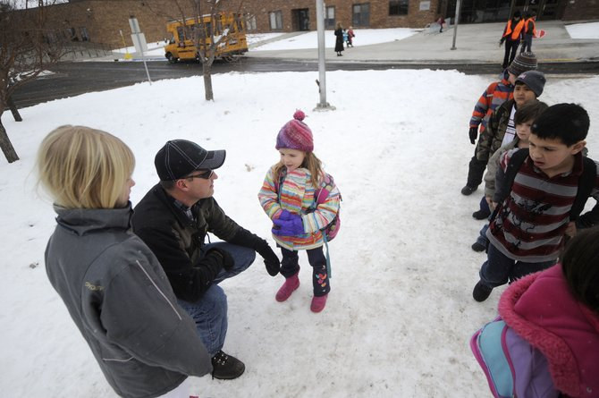 "Dan Brabec picks up his 5-year-old daughter, Haley, from Strawberry Park Elementary School on Friday. ""I don't know how we've gotten to the point where it's even an option for someone to do something like that. It's really scary, to be honest,"" Brabec said when asked about the school shooting in Newtown, Conn., on Friday."