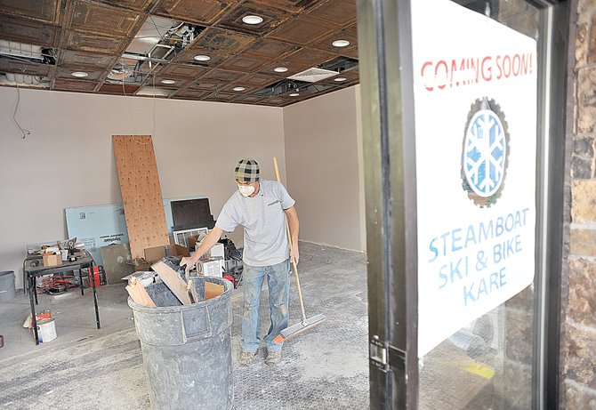Jerrod Aragon, of Architectural Hardwood Floors, cleans up the space where Steamboat Ski and Bike Kare will open a mountain location in addition to its downtown storefront. Owner Harry Martin plans to open the shop on Dec. 23.