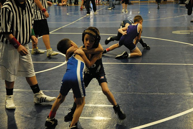 Ethan Vasquez of the Bad Dogs wrestling moves in for a takedown on his opponent during the Bad Dogs Winter Rumble on Dec. 15 at Moffat County High School.