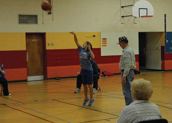 Makaylah Hampton, 11, puts up a foul shot during the Elks Hoop Shoot Saturday morning at Sandrock Elementary. Hampton hit 15 of 25 free throws to win the contest for her age group in Craig. She will have an opportunity to travel to Glenwood Springs for the district competition.