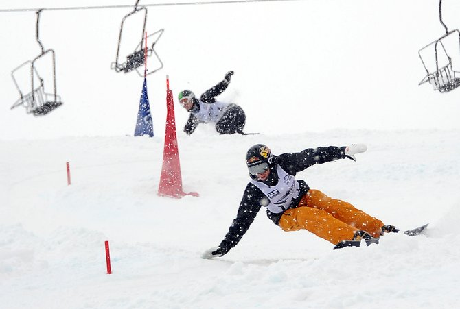 Steamboat Springs snowboarder Justin Reiter cuts through the course on another snowy day at Howelsen Hill. Reiter won Saturday's NorAm Race to the Cup parallel slalom in Steamboat Springs. He also won Friday's parallel giant slalom.