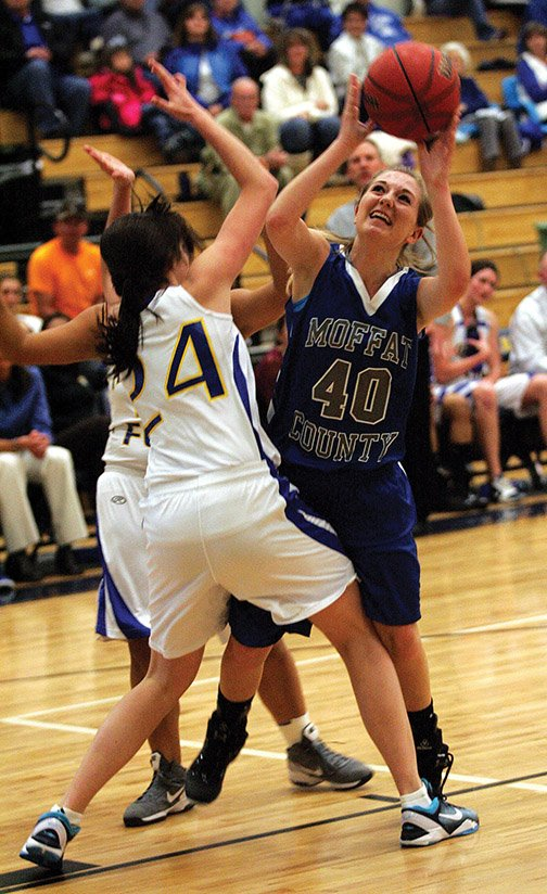 Moffat County senior Makayla Camilletti puts up a shot in the face of pressure from Roaring Fork's Hattie Gianinetti.