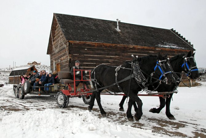 Dan Johnson drives Buddy and Dez down the trail Saturday at Wyman Museum. Johnson brought his horses out to provide sleigh rides during the sixth annual Wyman's Christmas for Kids.