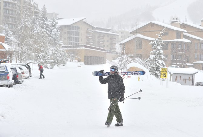 Steamboat Springs resident Dave Ince heads back to his car after spending Tuesday morning skiing. Skiers and snowboarders were greeted by more snow Tuesday morning as storms continue to move through the area.