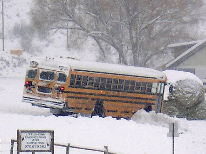 No one was injured after a school bus loaded with children slid on a slick county road and into a car Tuesday morning at Routt County Roads 129 and 52E.