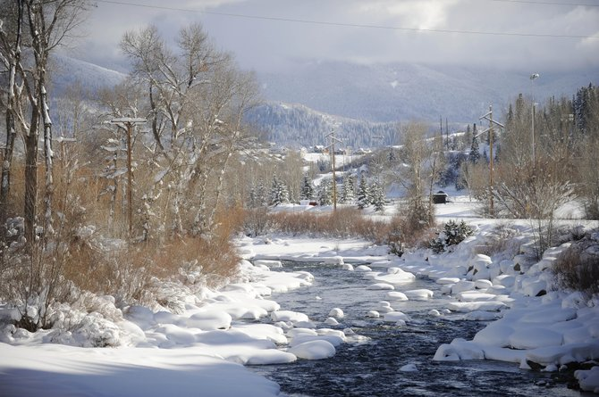 Pillows of snow dot the Yampa River on Wednesday.