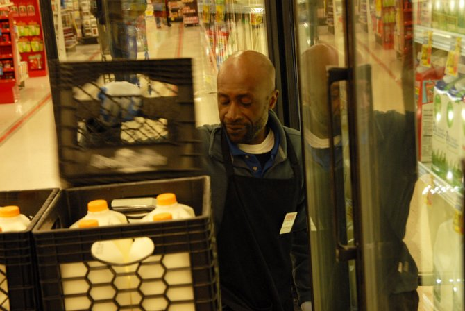 "Marcus Johnson, 48, works in the dairy section at City Market in Craig, the area he calls his ""world."" Johnson has befriended a great deal of customers during his recent seven months working at the store."