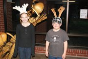 Nikki Currie, a fifth grader at Sandrock,left, and Garrett Anson, a second grader at East, play around as reindeer Thursday at the Moffat County Youth United Way and Key Club's Festival of Trees.