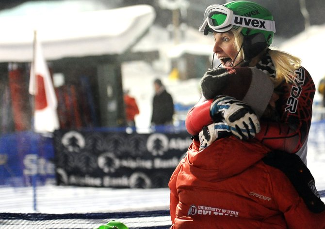 University of Utah's Ana Kobal celebrates with a teammate Thursday after learning she'd won the first of three slalom events in Steamboat Springs for the Holiday Classic. Kobal finished with about a two-second cushion on the field.