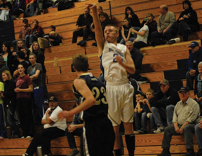 Sophomore Tyler Davis puts up a baseline three during the Moffat County boys basketball game vs. Olathe Friday night in Craig. The Bulldogs won going away in the second half, 59-32.