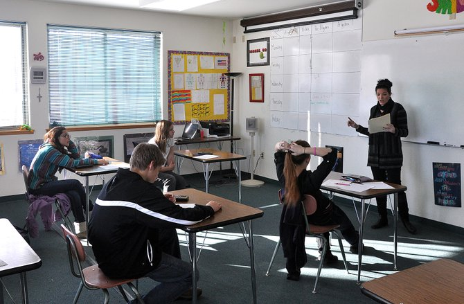 Angela Bogenrief teaches a math class Thursday at Heritage Christian School. The school will launch its first J-term next month after Christmas break.