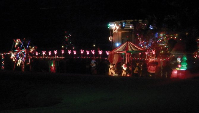 Mick and Nancy O'Conor, of 401 Ellis Ave. in Maybell, are the winners of the 2012 Holiday Tour of Lights. Their winter carnival theme impressed judges for its originality and creativity.