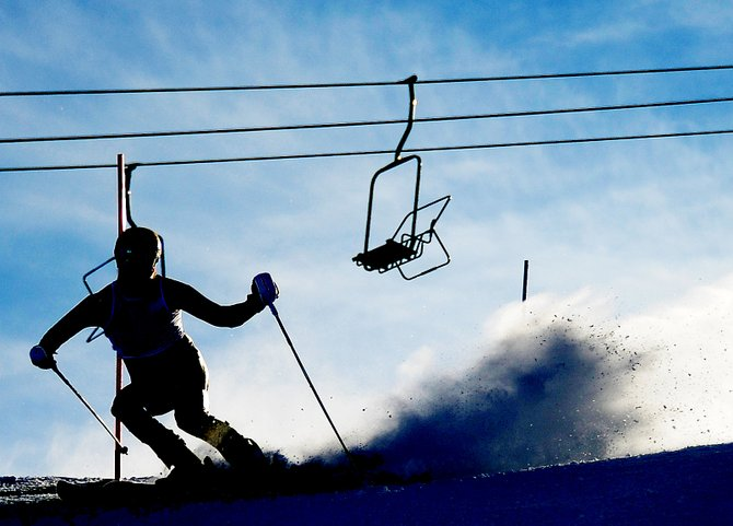 A skier cuts down the face of Howelsen Hill on Saturday during the Holiday Classic slalom races in Steamboat Springs. The three days of racing drew a large contingent of Steamboat Springs athletes, and those skiers and their coaches say the weekend's success was a great sign for the local alpine racing program.