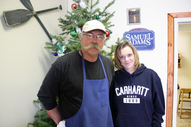 Erin Durham, right, with her father Dennis, manages Cool Water Grille and has been a part of the family-owned restaurant since their opening in September of 2011.