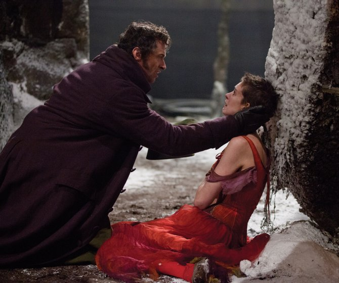"Jean Valjean (Hugh Jackman) reaches out to Fantine (Anne Hathaway) in ""Les Misérables."" The movie is an adaptation of the musical based on Victor Hugo's novel about an ex-convict in 19th century France attempting to escape his past."