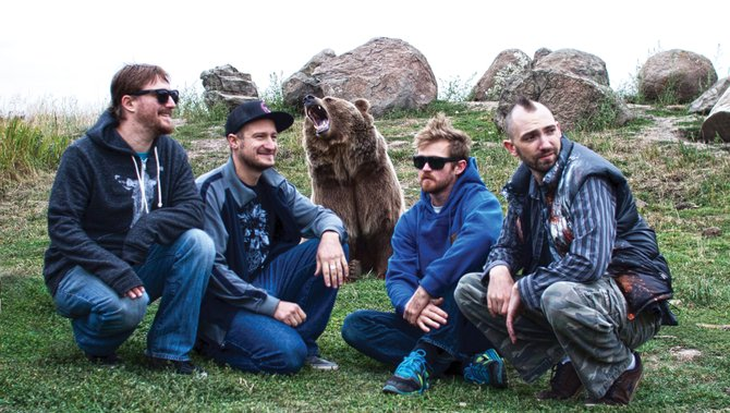 Front Range jam-tronic band Signal Path poses with a rescued grizzly bear named Brutus. The band returns to Steamboat to headline a show Friday at The Tap House Sports Grill. The cost is $7.