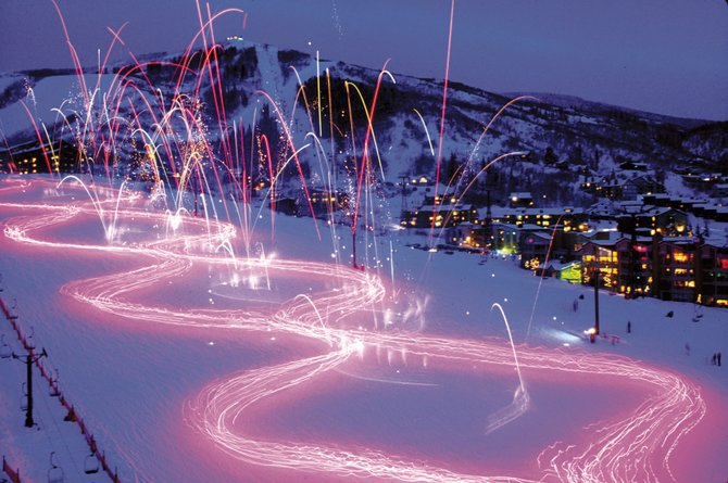 Steamboat Ski Area lights up Dec. 31, 2006, with the traditional torchlight parade and fireworks show to celebrate the New Year.
