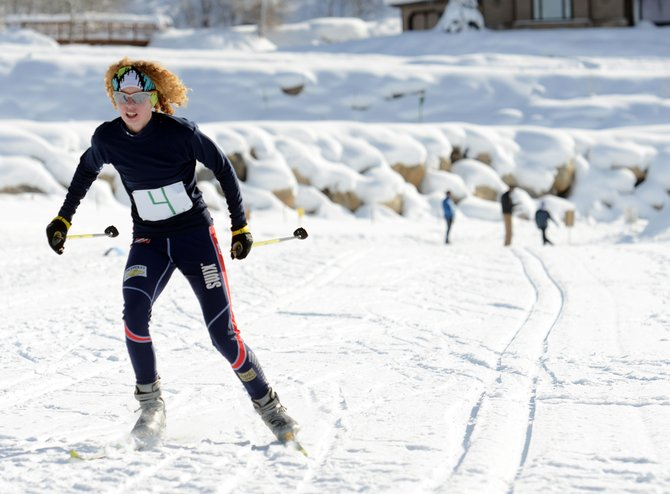 Tabor Scholl skis toward the finish line Saturday at the New Year's Relay at the Steamboat Ski Touring Center in Steamboat Springs. Scholl joined with her brother and father to win the 27th annual event. The day's longest event sent three skiers from each team on 7.2-kilometer loops.
