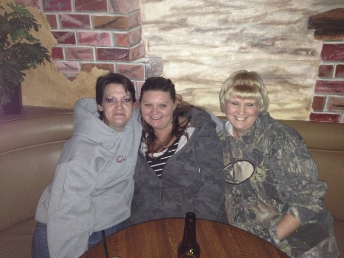 Stefene Sisson, left, Suzy Chad, center and Misty Hemlin, right, celebrate New Years at Mather's.