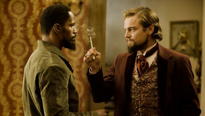 "Django (Jamie Foxx) meets depraved plantation owner Calvin Candie (Leonardo DiCaprio) for the first time in ""Django Unchained."" The movie is about a freed slave in the Deep South who teams with a bounty hunter to track down and rescue his wife."