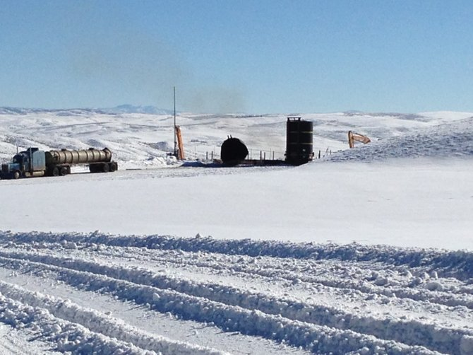A tank lies on its side after an explosion Thursday morning on Moffat County Road 103 at a tank battery site.
