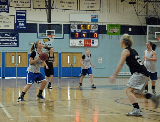 Moffat County High School senior Makayla Camilletti sets up for a three pointer Friday morning during a scrimmage game against the Meeker High School Cowboys at MCHS. With one week left in the winter break coaches Matt Ray and Greg Chintala wanted to square off to get both teams ready to return to league play.
