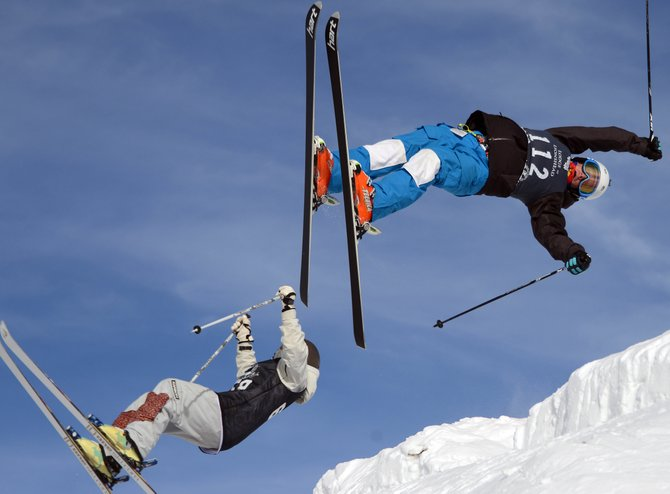Steamboat skier Michael Degrandis flips through a trick Sunday during a dual moguls competition at Steamboat Ski Area. Degrandis won the event, leading the way for a number of his teammates who managed to place high.
