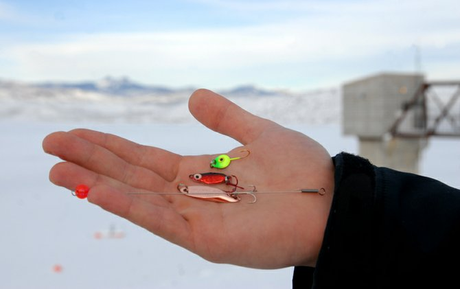 Rich King, an avid ice fisherman and owner of Auto Parts of Craig, keeps a handful of go to lures on hand anytime he treks out for a few hours on the ice including, from top, a green Gem-N-Eye jig, a red Frostee Spoon, and a copper KastMaster. Because fish tend to bite softly during the winter months no outfit is complete without a strike indicator, shown at bottom.