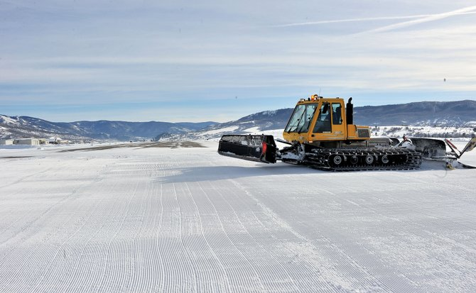 "Snow cat operator David ""Marv"" Shively finishes tilling and compacting the snow alongside the runway at the Steamboat Springs Airport. Airport Manager Mel Baker said the new idea for handling snow at the airport can help make it safer for pilots and planes."