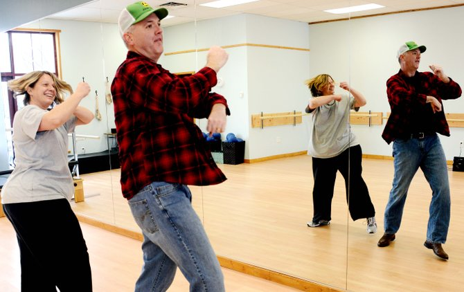 Steamboat Pilot & Today General Manager Scott Stanford practices a dance routine last month with choreographer Julie Tucek at Bella Barre studio. The pair will perform at Saturday's Dancing with the Stars benefit for Northwest Rocky Mountain CASA.